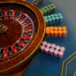 Gambling table with roulette in casino — Stock Photo