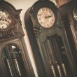 Three vintage wooden floor clocks — Stock Photo
