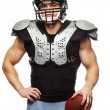 American football player with ball wearing helmet and protective shields — Stok fotoğraf