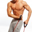 Handsome man with muscular body doing fitness exercise — Stock Photo #36576409