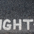 Turn right sign on an asphalt — Stock fotografie