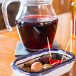 Sangria pitcher with plate of small tasty snacks on a table — Stock Photo #36577789