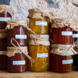 Glass jars with a different type of jams — Stock Photo