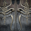 Old wooden door with beautiful decoration — Stock Photo
