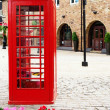 Traditional british red phone booth — Stock Photo #36578523