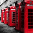 Traditional british red phone booths in a row — Stock Photo