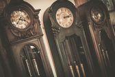 Three vintage wooden floor clocks — Stock Photo