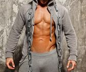 Sporty muscular man in grey hoodie with heavy metal chain — Stock Photo