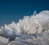 Sharp pieces of ice against blue sky — Stock Photo