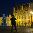 Stock Photo: Mwith tripod taking picture on Burg square in Bruges, Belgium