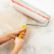 Doing wallpainting with a roller — Stock Photo