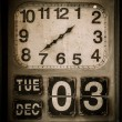 Foto Stock: Vintage clock with a calendar