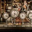Vintage clocks on a bar counter in a pub — Stock Photo