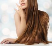 Beautiful young girl with long over blurred background — Stock Photo