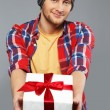 Stock Photo: Stylish young min shirt and beanie hat with gift box
