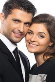 スーツと白い背景で隔離のドレスで美しい若いカップル — ストック写真