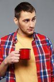 Stylish young man with a metal mug — Stock Photo