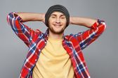 Stylish young man in shirt and beanie hat — Stock Photo