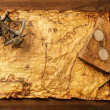 Sextant, old book and glasses on vintage map over wooden background — Stock Photo