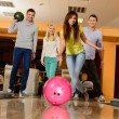 Group of four young smiling people playing bowling — стоковое фото #39147387