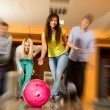 Group of four young smiling people playing bowling — Foto Stock #39147425