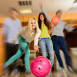 Group of four young smiling people playing bowling — Foto Stock #39147503