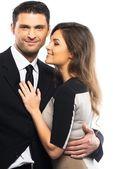 Casal jovem bonito de terno e vestido isolado no fundo branco — Fotografia Stock