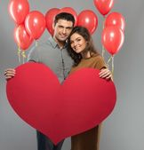 Happy couple handmade paper heart and red balloons — Foto Stock