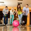 Group of four young smiling people playing bowling — Stockfoto #39601595