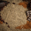 Coffee and cocoa theme still-life on sackcloth with copy-space — Stock Photo