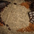 Coffee and cocoa theme still-life on sackcloth with copy-space — Stock Photo #39602357