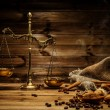 Coffee theme with brass scales still-life on wooden table — Stock Photo #39602411