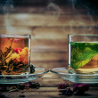 Glass cups with tea against wooden background — Stock Photo #39602461