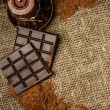 Cocoa and chocolate still-life on sackcloth with copy-space — Stock Photo