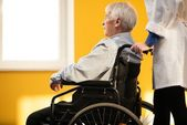 Nurse woman with senior man in wheelchair r — Stock Photo