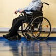 Stock Photo: Thoughtful senior min wheelchair in nursing home