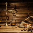 Coffee theme with brass scales still-life on wooden table — Stock Photo