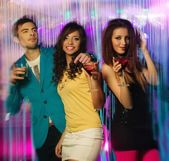 Group of happy young people dancing at night club — Stockfoto