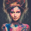 Young woman muse with creative body art and hairdo — Stock Photo #40586407