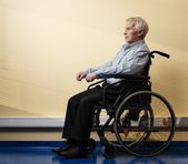 Thoughtful senior man in wheelchair in nursing home — Stock Photo