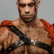 Stock Photo: Wounded gladiator close-up