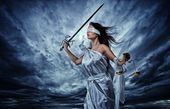 Femida, Goddess of Justice, with scales and sword wearing blindfold against dramatic stormy sky — Stock Photo