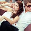 Young sexy couple relaxing on summer cafe terrace — Stock Photo #41476417