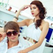 Young sexy couple relaxing on summer cafe terrace — Stock Photo #41476419