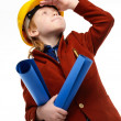 Little boy with plans and toolbox playing engineer role  — Stock Photo #41476843