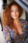 Beautiful middle-aged redhead woman in a luxury car interior  — Foto de Stock