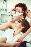 Young sexy couple relaxing on summer cafe terrace  — Stockfoto