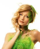 Beautiful young woman in conceptual spring costume  — Stock Photo