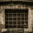 Window with lattice in old building — Stock Photo