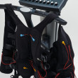 Training suit hanging on Modern Electro Muscular Stimulation EMS machine  — Stock Photo #41872709